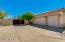 3 car oversized garage and side gate entrance to back yard