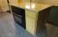 Slab granite and plenty of storage make this kitchen shine!