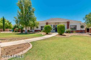 Gorgeous custom home on a 30,041 sf north/south facing lot.