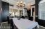 Formal dining area with coffered ceilings and upgraded fixtures throughout.
