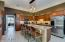 Massive kitchen with corian counters & stainless steel appliances.