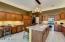 Kitchen has desk area.