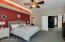 Spacious master bedroom has double doors & high ceilings.