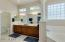 Palatial master bath with plenty of windows for natural light.