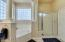 Master bath has a separate tub and shower.
