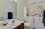 Bathroom 3 has a walk-in tub and shower.