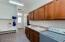 Cabinets on both sides of the laundry room.