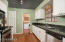 Beautifully remodeled kitchen with RO and Insta-hot water faucet. Laundry room off kitchen with door to outside.