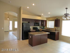 VIEW OF KITCHEN FROM FAMILY ROOM.