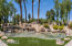 Beautiful pond with oversized water feature nestled right in the entry of this beautiful community.