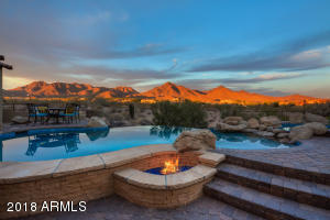 Gas firepit and poolside views.
