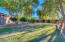 Large fenced grass area w/mature trees
