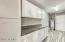 Large laundry room with ample storage and work space