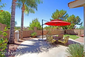 Enjoy this private backyard with low maintenance landscaping.
