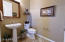 Conveniently located off the GREAT ROOM is a large POWDER ROOM for your guests when entertaining