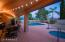 Large covered patio area. Perfect for enjoying dinner outside. Area overlooks the beautiful pool/spa area. Turn on the pool fountains on and relax to the sound of a gentle water fall.