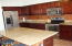Kitchen with Granit counter tops/ Stainless frig and stove.