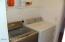 Washer & Dryer with upper storage rack.