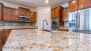 Lovely and large granite kitchen island. Great for cooking, entertaining and dining.