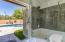 French doors from master bath to the pool area.