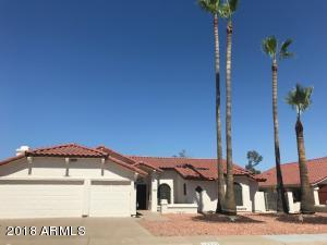 Four Palm trees are the landmark as there is no sign on the property.