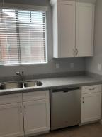 Welcome to your kitchen! Granite counter tops and high quality white shaker cabinets.