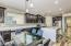 Multiple eating areas - kitchen dining table or eat at the breakfast bar center island.