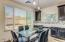 Fantastic eat-in kitchen with view of your backyard and plenty of quartz counters and cabinetry for storage.