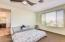 Welcome to your master bedroom with ceiling fan.