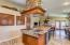 Gourmet kitchen with high end appliances, built in spice racks, custom stone work.