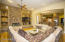 Expansive family room with stack stone wall and gas FP