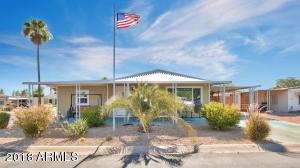 Enjoy an incredible corner lot in beautiful Palm Lakes Village 55+ community!