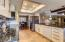 Kitchen opens to family room and has large 'breakfast bar' for informal meals