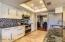 Remodeled kitchen with grantie tops and decorative tile backsplash