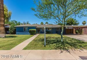 Charming single level home with deep, grassy front and back yards