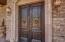Double doors. Behind these there is a private interior entryway with another set of doors to the home.
