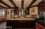Limestone counters, authentic beams, all of the accoutrements you would expect in a kitchen of this caliber home.