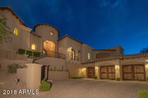 Beautiful Rotunda Entry with custom Iron Work, Lighting, Garage Doors, Pavers