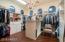 Spacious Master Bedroom Walk-in Closet with Custom Organization and Granite Island