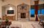 Grand Cantera Stone Gas Fireplace and Surround extends to Entertainment Center