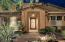 TUSCAN ARCHITECTURAL DETAIL AND WELCOMING FRONT PORCH