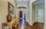 Gorgeous entry to home. Showing the beautiful hickory wood flooring.