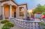 Charming front courtyard with single gate to backyard. Double gate on other side.