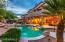 Resort style back yard with pebble finish pool offering huge lagoon step