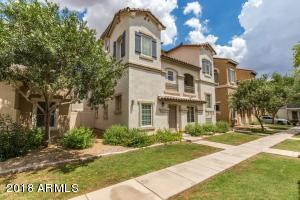 LOVELY WELL MAINTAINED GROUNDS SURROUND THIS SIDE BY SIDE TOWNHOME.