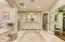 Huge custom master bath features all new custom cabinetry, flooring, shower, closet doors and finishes!