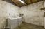 Spacious Laundry Room & Workshop.