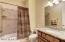 Hall Bath Near Kitchen and Laundry Room