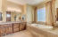 Gorgeous Master Bathroom with Double sinks, jetted tub and tons of light and cabinet storage