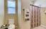 Jack-n-Jill Bathroom connects to Bedroom 1 & 2. Custom Tile work in bath/tub combo.